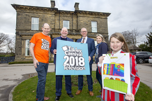 Ilkley Primary pupil posing with her winning Ilkley Carnival design