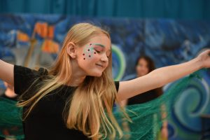 Actress in 'The Tempest' Schools edition acting on stage