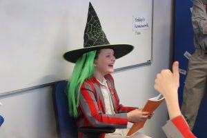 A pupil awaiting her fate after she has pleaded her case to the sorting hat in English lesson