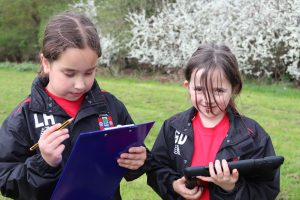 Two pupils searching for different plants
