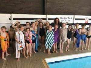Pupils celebrate their silver trophy win at the inter schools swimming gala