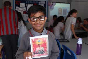 School pupil stands with his own storybook
