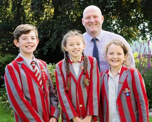 Photo shows Ghyll Royd School's Head Girl and Deputy Head Boy and Girl with Headteacher Mr David Martin