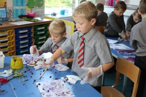 Ghyll Royd School boys paint with juice from berries