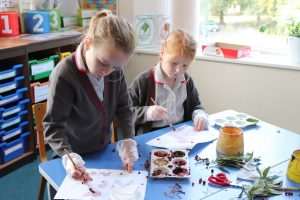Ghyll Royd School girls paint with juice from berries