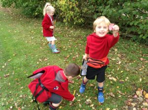 Ghyll Royd Pre-School child finds leaf on welly walk