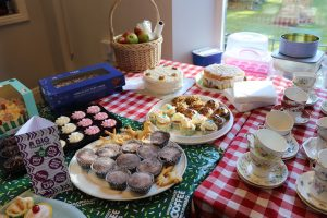 Grandparents' Day and Macmillan Coffee Morning - a table full of cakes and buns donated and ready to raise money