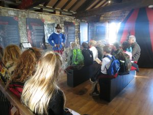 Ghyll Royd School pupils gather around to listen to Crime and Punishment workshop at Henry VII Experience