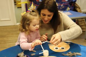 Ghyll Royd School playgroup: mum and toddler making craft owls