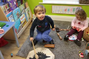 Ghyll Royd School playgroup visitor banging a drum
