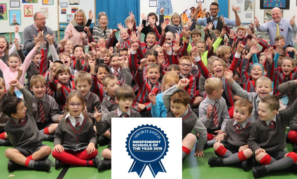 Ghyll Royd pupils throw their arms in the air in celebration at being nominated for Best Prep School