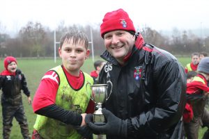 Ghyll Royd pupil with house trophy and Headteacher Mr Martin