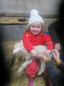 Ghyll Royd Pre-School pupil pictured with lamb