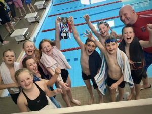 Wharfedale Primary pupils from Ghyll Royd celebrate winning the swimming gala