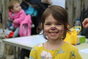Ghyll Royd School pupil smiles with bunny face paint