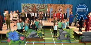 Ilkley Primary pupils at Ghyll Royd School performing on stage in their end of year show