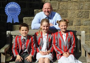 Independent School pupils from Ghyll Royd pose with headteacher David Martin in school courtyard