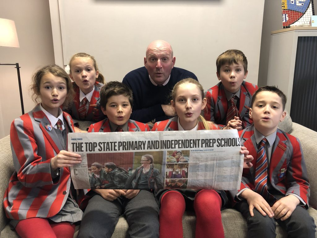 Ghyll Royd School pupils and Headteacher David Martin marvel at their name appearing in the Sunday Times 2020 School Guide