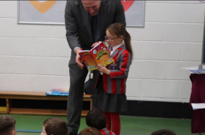 Ghyll Royd pupil reads out her published poem