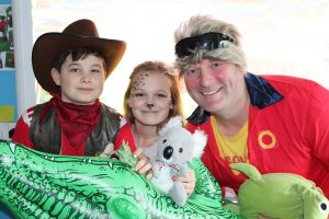 Ghyll-Royd-School's-Headteacher-David-Martin-with-organiser-Sophie-Barraclough-and-School-Council-Lead-George-Lewis-dressed-as-a-lifeguard-an-animal-and-Crocodile-Dundee.