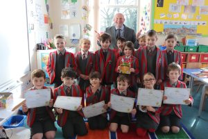 Ghyll Royd School Key Stage 1 children smiling with their certificates from being published poets