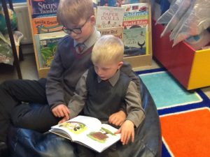 Ilkley Primary children at Ghyll Royd School are reading together