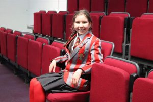 Ghyll Royd Head Pupil Georgie sat in the school's new theatre