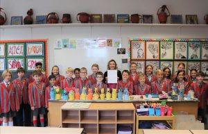 Ilkley Primary - Ghyll Royd pupils in art room with Art teacher Miss Smith holding their artsmark school silver award